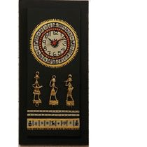 This beautiful black and golden wooden wall clock has dhokra metal work on it and warli art work around the dial and the bottom of the clock.
