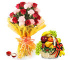 Giftacrossindia Bhai Dooj Hamper Roses and Carnation Bouquet with Fruits Basket (GAIBD2016012)