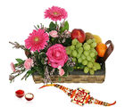 GiftsAcrossIndia Flowers And Fruits In Basket With Rakhi Express (GAIR2016294)