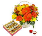 Giftacrossindia Bhai Dooj Basket Arrangement of Mix Flowers and Assorted Sweets (GAIBD2016009)