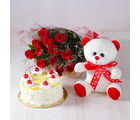 Giftacrossindia Forever Red Roses with Half kg Pineapple cake and Soft Toy (GAIMPHD0493), 1000 gms