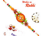 Aapno Rajasthan Flower And Leaves Beautiful Rakhi, orange and green, one rakhi with 200 gms kaju katli