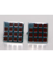 BLACKSMITHH CUFFLINKS- Fiftenn Small Red Enamel Squares Set Within A Square With A Missing Abstract Square